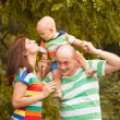 Happy family having fun outdoors on a summer day — Stock Photo #52891613