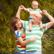 Happy family having fun outdoors on a summer day — Stock Photo #52891615