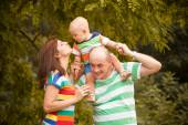 Happy family having fun outdoors on a summer day — Foto Stock