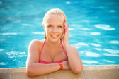 Fashion portrait of beautiful and sexy women in pool — Stock Photo
