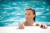 Fashion portrait of beautiful and sexy women in pool — Foto Stock