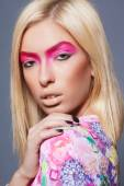 Fashion blonde supermodel in pink dress, closeup studio shot — Stock Photo