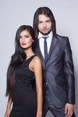 Fashion style photo of beautiful couple, studio shoot — Stock Photo