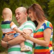 Happy family having fun outdoors on a summer day — Stock Photo #53738439