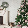 Image of chimney and decorated xmas tree with gift — Stock Photo #56504813