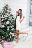 Fashion and sexy african woman decorating christmas tree — Stock Photo
