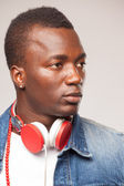 Handsome African man listening to music on DJ headphones — Stock Photo