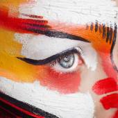 Beautiful fashion woman with bright color face art and body art. Paint on face.  Creative portrait — Stock Photo