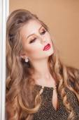 Gorgeous Fashion Model in Ceremonial Shiny Dress with beautiful make-up — Stock Photo