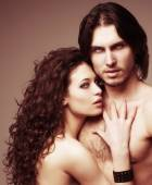Glamorous portrait of a pair of vampire lovers — Stock Photo