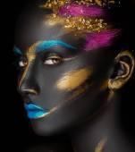 Close-up fashion portrait of a dark-skinned girl with color make-up — Stock Photo