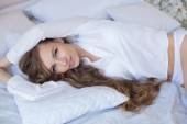 Sensual and beautiful woman in lingerie in the bed — Stock Photo