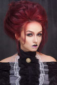 Sexy woman with gothic makeup and red hair — Stock Photo