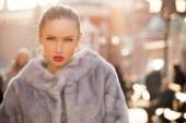 Fashion woman with red lips walking in the city — Stock Photo