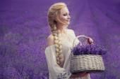 Romantic portrait of beautiful woman on the lavender field — Stock Photo