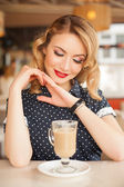 Retro beautiful woman in restaurant cafe with coffee — Stock Photo