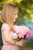 Beautiful baby girl with blonde  hair outdoors. Little girl 2-3 year old — Stock Photo