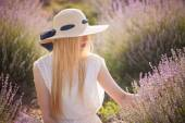 Beautiful woman with long blond hair in the lavender field — Stock Photo