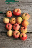 Apples on wooden bench — Stock Photo