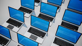 3d image of a lot of laptops in a rows. — Stock Photo