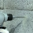 Drilling hole into concrete wall. — Stock Video #59339167