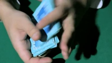 Two hands, shuffling a deck of cards — Stock Video
