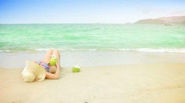 Woman with coconuts beach — Стоковое видео