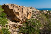 Weathered rocks of Sardinia and abandoned barracks  — Stock Photo