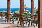 Tables and chairs near the sea beach — Stock Photo