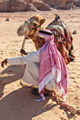 Camel and Bedouin in the desert — Stock Photo