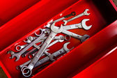 Combination wrench in a red toolbox  — Stock Photo