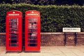 Art row of traditional phone boxes in London city  — Stock Photo