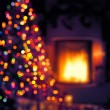 Art Christmas scene with tree gifts and fire in background — Foto Stock #57819765