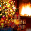 Art Christmas scene with tree gifts and fire in background — Stok fotoğraf #57837799