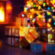 Art Christmas scene with tree gifts and fire in background — Foto Stock #57894445