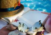 Art Straw hat , book and Sunglasses on the beach — Stok fotoğraf