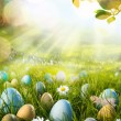 Art decorated easter eggs in the grass with daisies — Stock Photo #65298267