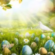 Art decorated easter eggs in the grass with daisies — Stock Photo #65300509