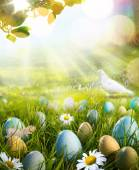 Art decorated easter eggs in the grass with daisies — Stock Photo