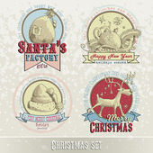 Set of Christmas emblems and designs — Stock Vector