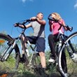 Cyclists kissing and riding on bikes — Stock Video #66467551