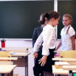 Pupils walking in the classroom — Stock Video #66468027