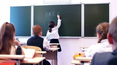 Schoolgirl writing text back to school — Stock Video