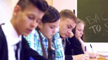 Students writing task on examination — Stock Video