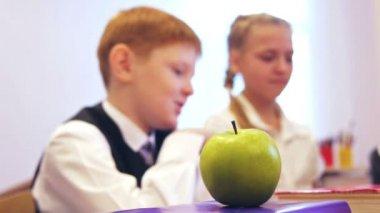 Schoolboy taking apple — Stock Video