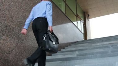 Businessman walking the stairs to work — Stock Video