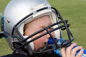 Thirsty Young Football Player — Foto Stock