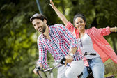 Couple riding on bicycle — Stock Photo