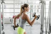 Young woman training in the gym — Stock Photo
