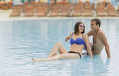 Couple by the pool — Stock Photo
